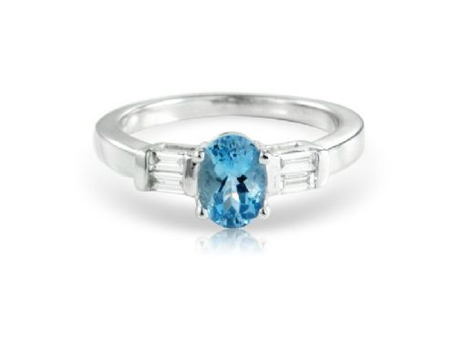 White gold oval cut aquamarine and diamond ring